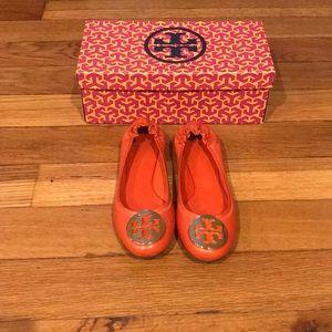 Tory Burch orange leather ballet flat.
